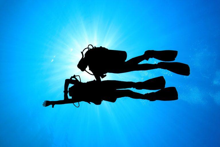 Two divers practicing underwater navigation.
